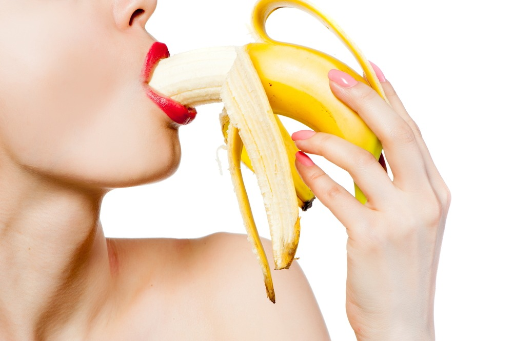 women eating banana