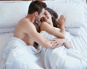 happy married couple in bed