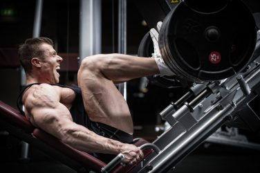 strong man doing heavy leg press