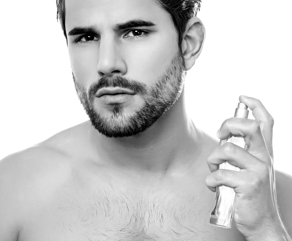 gorgeous man spraying cologne, sexiest colognes