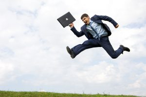 energetic businessman jumping high