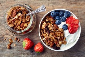yogurt with granola and fruits taken with Progentra pills