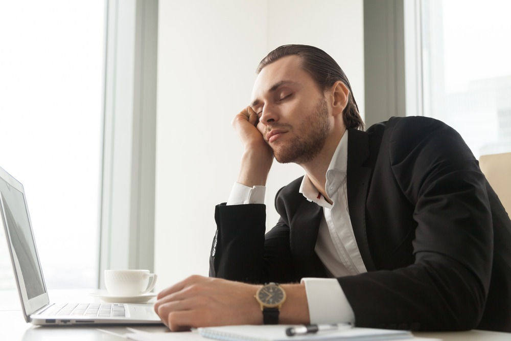 exhausted man in office, adrenal fatigue