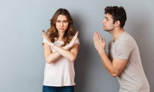 man pleading with woman who is not consenting