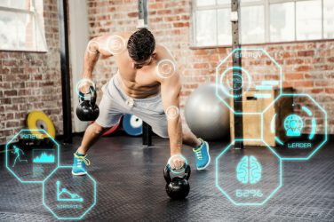 fit man lifting kettlebell with fitness interface