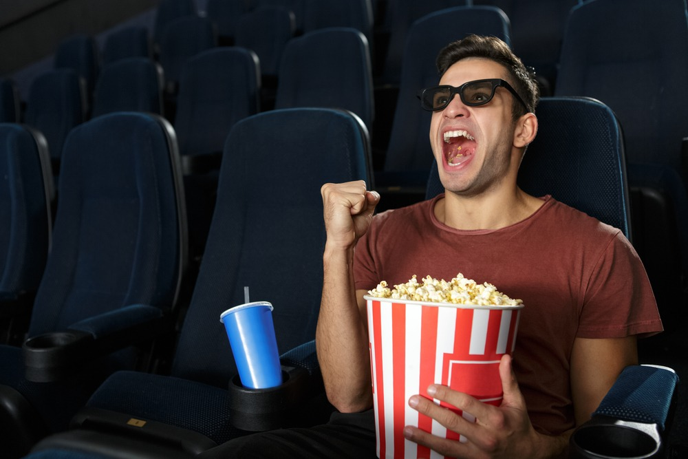 man who takes Progentra enjoying movie in theater