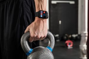 man wearing smart watch to track workout