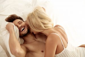 couple happy in bed man laughing after Progentra intake