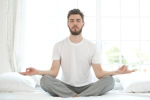 man meditating after taking his Progentra supplement before going to bed