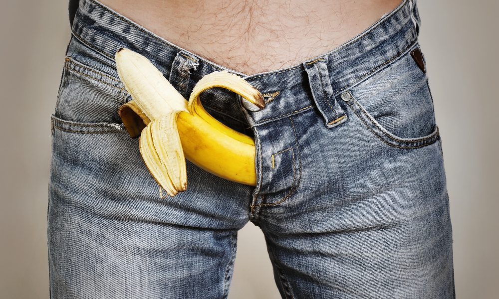 peeled banana in jean crotch representing circumcised penis