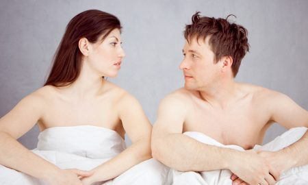 couple in bed talking about trying Progentra supplement to address delayed orgasm