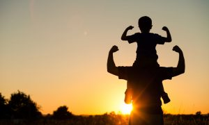 silhouette of a father and child