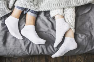 couple in bed with socks on